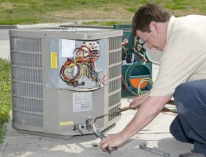technician-welding-connection-for-ac-installation